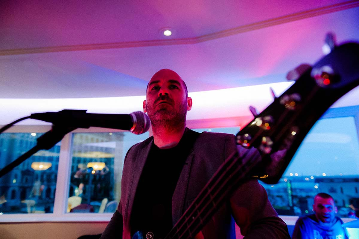 Live Wedding Band Slinky | Rock Pop and Indie Wedding Band | The bassist performing at a wedding reception.
