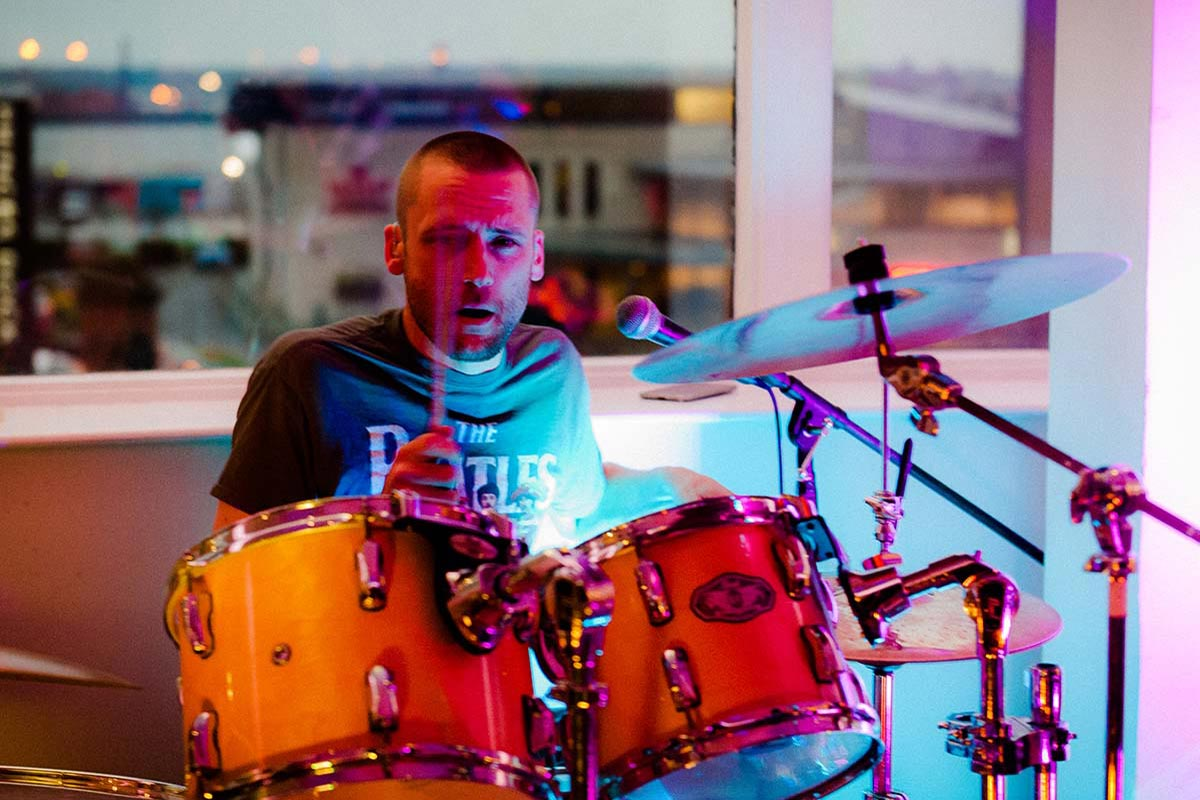 Live Wedding Band Slinky | Rock Pop and Indie Wedding Band | The drummer performing at a wedding reception.