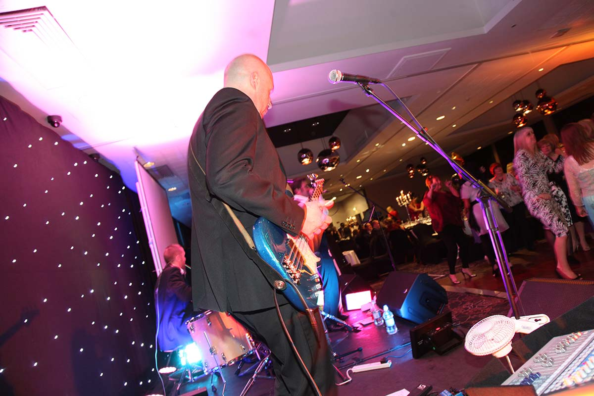 Live Wedding Band Slinky | Rock Pop and Indie Wedding Band | Bassist performing at birthday party 3.