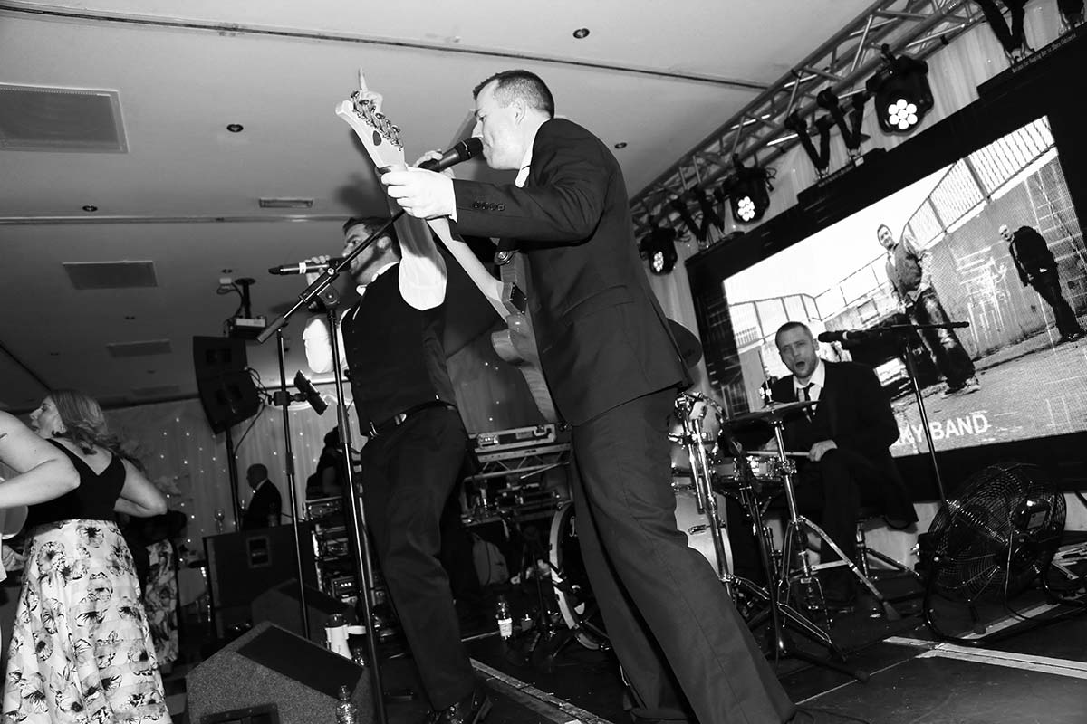 Live Wedding Band Slinky | Rock Pop and Indie Wedding Band | The guitarist joins in with the singing at a corporate event.