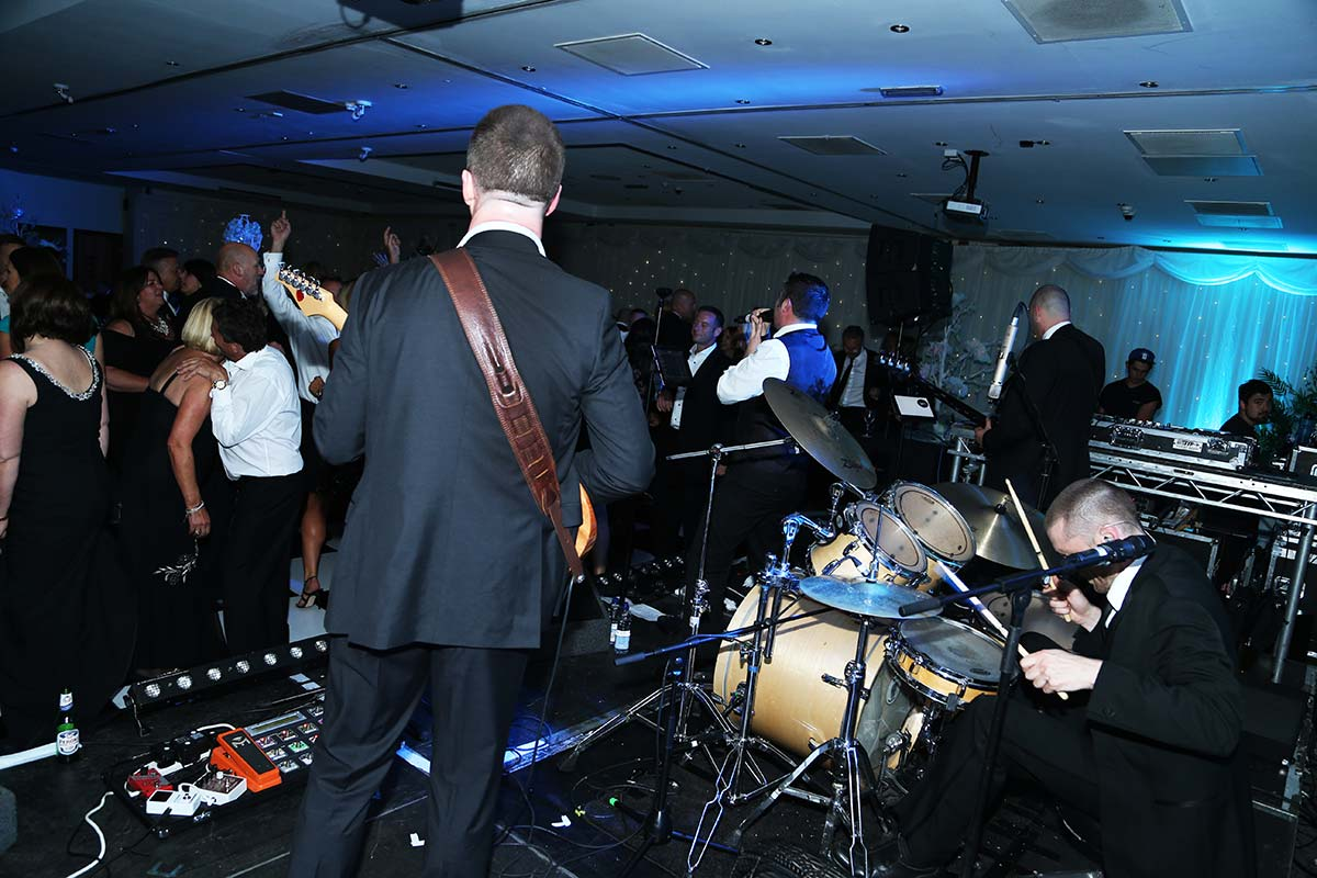 Live Wedding Band Slinky | Rock Pop and Indie Wedding Band | On stage with Slinky at a corporate event 2.