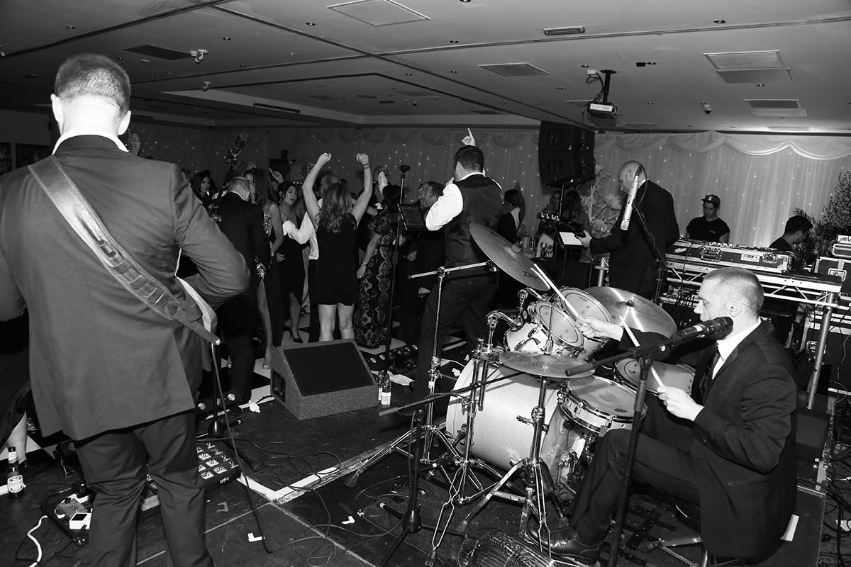 Live Wedding Band Slinky | Rock Pop and Indie Wedding Band | On stage with Slinky at a corporate event.