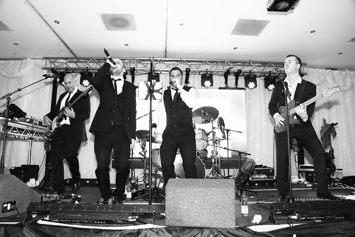 Live Wedding Band Slinky | Rock Pop and Indie Wedding Band | The singer and drummer lead the band together at a corporate event 2.