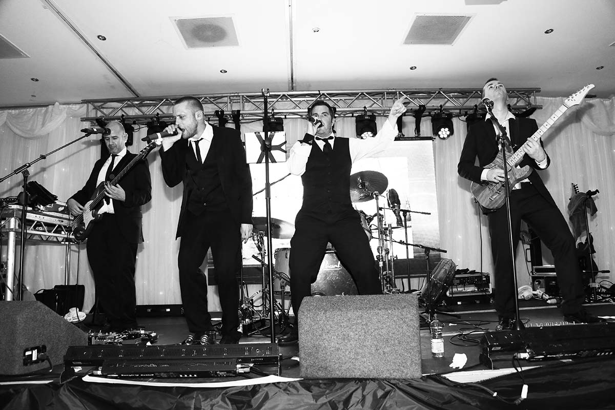 Live Wedding Band Slinky | Rock Pop and Indie Wedding Band | The singer and drummer lead the band together at a corporate event.