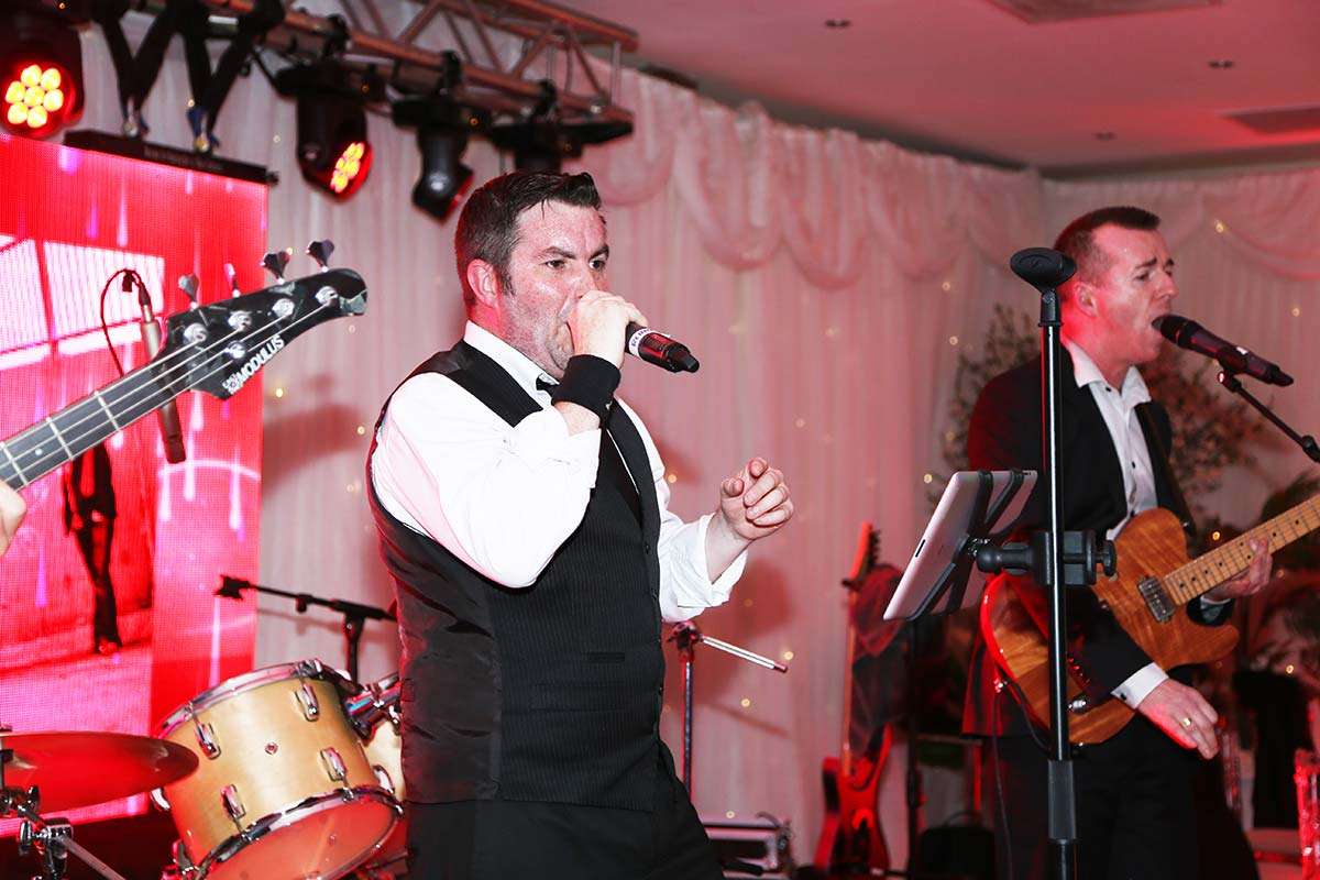 Live Wedding Band Slinky | Rock Pop and Indie Wedding Band | The singer and guitarist sing a song together at a corporate event.