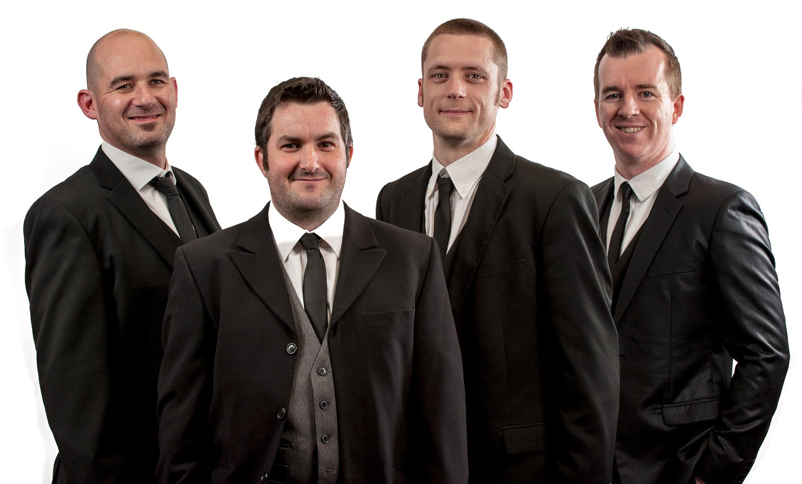 Live Wedding Band Slinky | Rock Pop and Indie Wedding Band | Band dressed in suits.