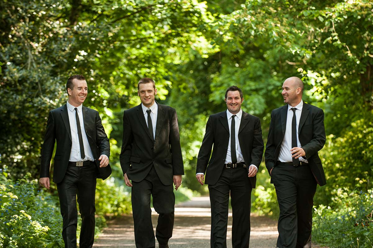 Live Wedding Band Slinky | Rock Pop and Indie Wedding Band | Shot of the band walking in the park.